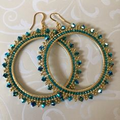 Extra Large Crystal Seed Bead Hoop Earringsp  Hoop earrings made with beautiful aqua jet Swarovski crystals and metallic pink and cream colored 11/0 beads. The color and sparkle of these gorgeous earrings is amazing. The french hook earwires and findings are 14kt gold plated.  These very large very