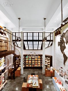 The Rockwell Group filled the Shinola shop in New York with materials that reference our country's manufacturing heritage, from brick walls to poured-concrete flooring. Photography by Eric Laignel. Commercial Design, Commercial Interiors, Rockwell Group, We Built This City, Restaurants, Shops, Shinola, Interior Design Magazine, Retail Space