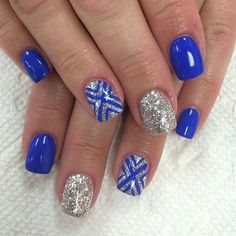 Make way for this royal blue and silver glitter ensemble. The nails are coated with royal blue matte and accented with silver glitter topped with royal blue symbols painted on top. If you want to look classy and sassy then this is the nail art to go for.: