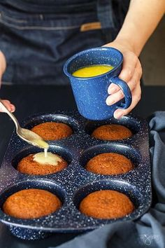 Pouring cream sauce over the hot malva pudding mini cakes.
