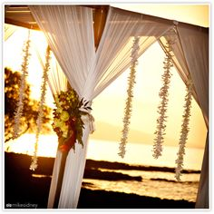 Floral wedding arch at sunset, Maui  www.mikesidney.com    The Wedding Lady - Exquisite Wedding Planning in Maui Hawaii and Vancouver BC    # weddinglady.com