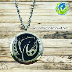 """Introducing our brand new Stainless Steel #essentialoil diffusing locket. This """"Exclusive"""" design is only available at Essential Bracelet. Each necklace comes with your choice of 20 inch or 22 inch chain and 5 diffusing pads. You will receive 4 different colors to match any outfit.  Check them out now at ://essentialbracelet.com/shop/stainless-steel/"""