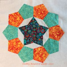 pentagon papers using English Paper Piecing created the wreath. diamonds formed the star. A perfect fit! English Paper Piecing, Pentagon, Perfect Fit, Quilting, Diamonds, Wreaths, Blanket, Stars, Fabric