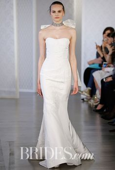 Brides.com: . Silk faille trumpet wedding dress with guipure embroidery, Oscar de la Renta