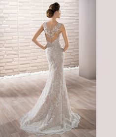 This stunning lace adorned sleeveless V-neck Sheath gown with Sweep train and striking low sheer back with lace and buttons exudes vintage glamour.