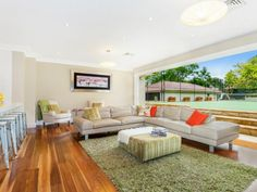 This living room opens right up to the tennis court