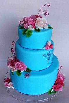 In love with this wedding cake. Blue cake with red and pink flowers.