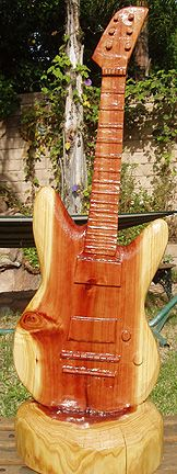 chainsaw carving guitar by Cherie Currie