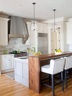 Kitchen Island With Bar Lowes Backsplash For Kitchens The Breakfast Under Place A Tall Table Next To Using Complementary Materials In This