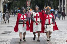 For England, and St George! Fans dressed as the patron saint of England gather in central Sao Paulo ahead of the England's match against Uruguay