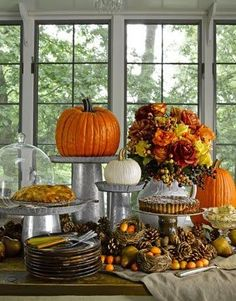 Thanksgiving / fall centerpieces for buffet table. Galvanized steel risers for dessert table, mix of small and large pumpkins