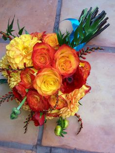 Konfetti rose bridal bouquet with orange and yellow dahlias and italian ruscus.