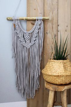 Pre-order • Macrame wall hanging Elea - custom colour Design is the same as wall hanging Silver Line Choose colour; • Anthracite • Charcoal (same as shown at picture/ready to send) • Graphite or contact me for other colour options Handmade Recycled fabric (tshirtyarn) Treebranch width