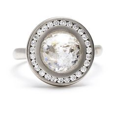The rose-cut center diamond in this remarkable ring encapsulates a world of sparkle. Surrounded by a channel-set pave diamond halo, this ri...