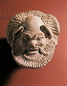 Terracotta antefix depicting satyr, from Gela, Sicily, Italy