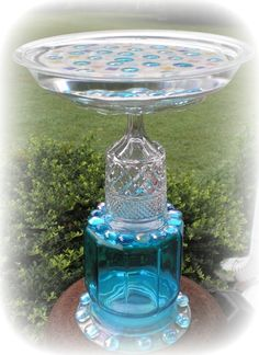"Garden Junk Art Birdbath / totem with glass ""gems"" Glass Bird Bath, Diy Bird Bath, Glass Birds, Garden Whimsy, Garden Junk, Glass Garden Art, Glass Art, Garden Totems, Garden Ponds"