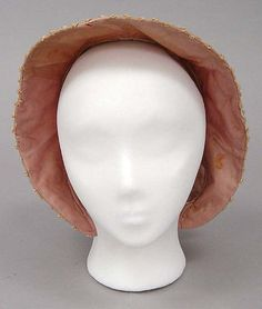 BonnetBonnet Date: 1863–67 Culture: American Medium: silk Dimensions: Length (at top): 8 1/4 in. (21 cm) Credit Line: Gift of Mrs. R. Houghton Trott, 1954 Accession Number: C.I.54.44.13