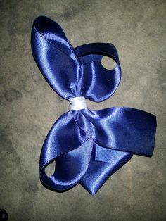 Large navy blue bow