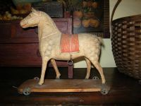 A very rare and unusual Victorian era 'squeaker' paper mache horse pull toy, probably made in Germany. It is in fantastic shape and when you pull on the little metal ring on its stomach...it actually 'neighs'! It can be found under the 'Early Toys' button on my website.