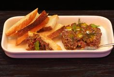 """Thrillist mentions Berkshire Room in the Acme Hotel: 'The snacks on the food menu are a modern take on 1940s food, such as bison tartare with caper relish, egg """"jam"""", and crostini."""