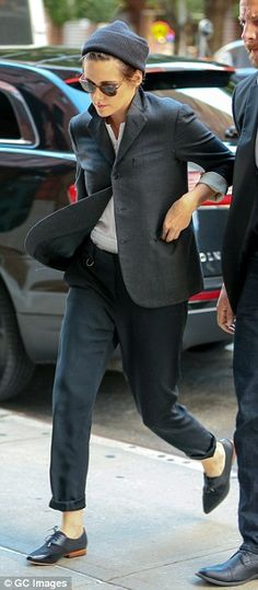 Suits her: She was pictured heading out in an androgynous ensemble earlier in the day...