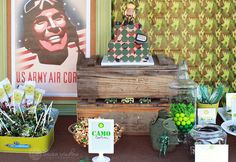 this party is so cute. I like the rustic touches.  I hope to use a wooden ammo box to elevate the cake/cupcakes.