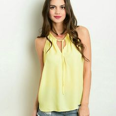 Soft yellow tank with tie up front Soft yellow tank with tie up front. 100% polyester Tops Tank Tops