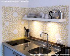 stenciling the marrakech trellis craft stencil on a kitchen