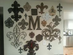 Fleur de lis decor wall, with our last name initial in the center.  Focal point wall.