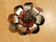 Pop can flower tutorial. --- use beer cans as bows on presents. Lol. How fun!