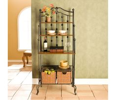 Saint Pierre Bakers Rack - Elegant and beautiful, this unique black frame baker's rack is a blend of form and function. Combining multiple shelves of varying sizes, a large tabletop workspace, and two spacious rattan storage baskets this kitchen organizer is sure to suit your needs. The decorative black frame is crafted from metal tubing to ensure strength and durability. www.millstores.com