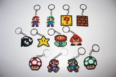 Mario Bros keychains. Super mario bros magnets. Hama beads mini 1up, goomba perler. Pixel art