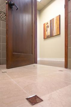 During your next remodel, consider forgoing the need for the standard metal threshold that marries your bedroom carpet to the en suite bath for a trip-free flooring transition.