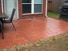 Brick-look, stamped concrete patio.