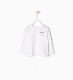 Image 1 of T-shirt with button neck from Zara