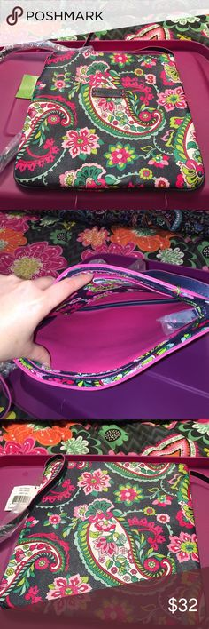 Vera Bradley slim hipster petal paisley Made of pvc. Outside has one big slip pocket. Main compartment has zip closure. Inside 1 slip pocket. Vera Bradley Bags Crossbody Bags