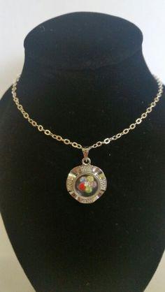 Silver - rhinestone flower spin charm. AUS $ 6.00