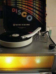 """Quite sure this is the coolest thing I ever owned (Disco Sound Machine, circa 1979).  Lights on the front blinked in groovy colors.  I have vivid memories of the elaborate decorations I put up in my room to make it look more """"disco-y""""  Oh, how my parents must have been laughing outside my door..."""
