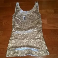 Sequin gold tank top Brand new sequin gold tank tops. Looks great under a blazer Old Navy Tops Tank Tops