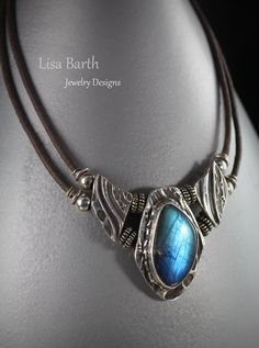 Fine silver metal clay with a beautiful Spectrolite as the centerpiece.  This is one of my favorites. -Lisa Barth