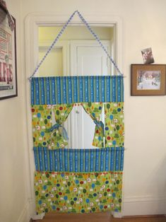 Doorway puppet theater- use spring loaded curtain rod on top!