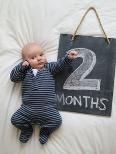 Celebrating 2 months with the 'Bolt' pose, via Flickr. #baby