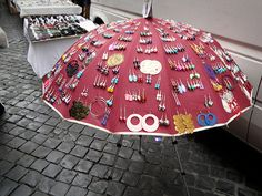 An old Umbrella is very unique way to display earrings etc.