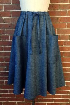Semi circle skirt has two big front patch pockets and an easy drawstring fit.