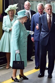 The Duchess of Cornwall wore an A-line knee-length coat in a very similar shade to the Queen.
