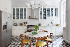 Alexander James via Desire to Inspire - Love the mix of al almost all white kitchen and those MCM chairs...