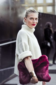 fur purse and knitted sweater