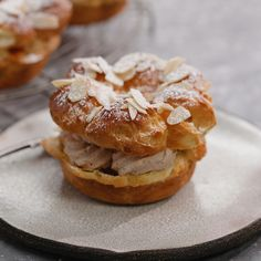 Paris Brest Dessert - - Paris Brest Dessert Fancy French Desserts This dessert is the tits! Delicious Desserts, Yummy Food, Best Desserts, Elegant Desserts, Gourmet Desserts, Baking Desserts, Mini Desserts, Plated Desserts, Kolaci I Torte