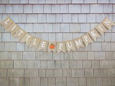 This listing is for a LIL PUMPKIN burlap banner. Banner details: - burlap pennants each measuring 4.5 inches wide by 6.5 inches long. -LIL PUMPKIN written in all uppercase letters in white - a pumpkin separating words -Flags are lightly treated to try to minimize fraying. -Banner is strung on twine -Total length of banner is approx. 52 inches long. - Plenty of extra twine on each end for hanging.  ** Customize this banner with the font and pumpkin colors of your choice!  These banners are…