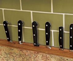 Knife storage along the back edge of cabinetry.  Photo: Alise O'Brien | thisoldhouse.com | from Kitchen Storage Design Ideas